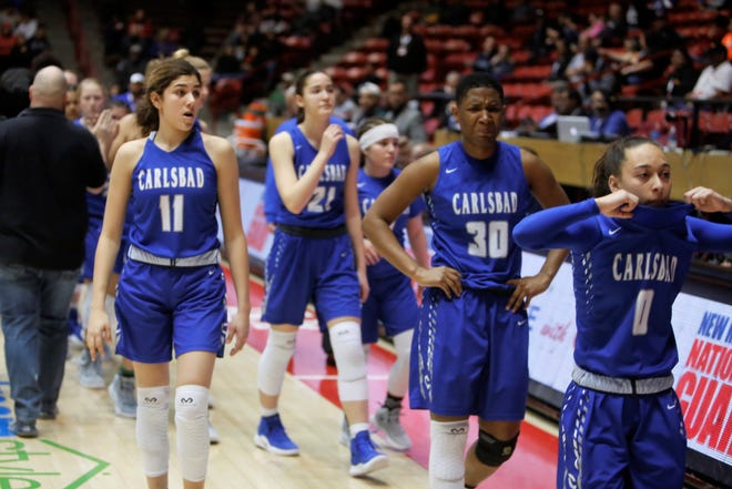 Carlsbad's Teran Tiller (11), Dayshaun Moore (30) and Baylee Molina (0) start walking back to the locker room following the Cavegirls' 42-41 loss to Hobbs in Thursday's 5A semifinals at Dreamstyle Arena in Albuquerque.