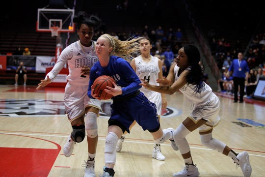 Carlsbad's Carsyn Boswell pushes toward the basket against Hobbs' Ayanna Smith (24) and Wisdom Anthony (10) during Thursday's 5A state semifinals at Dreamstyle Arena in Albuquerque.