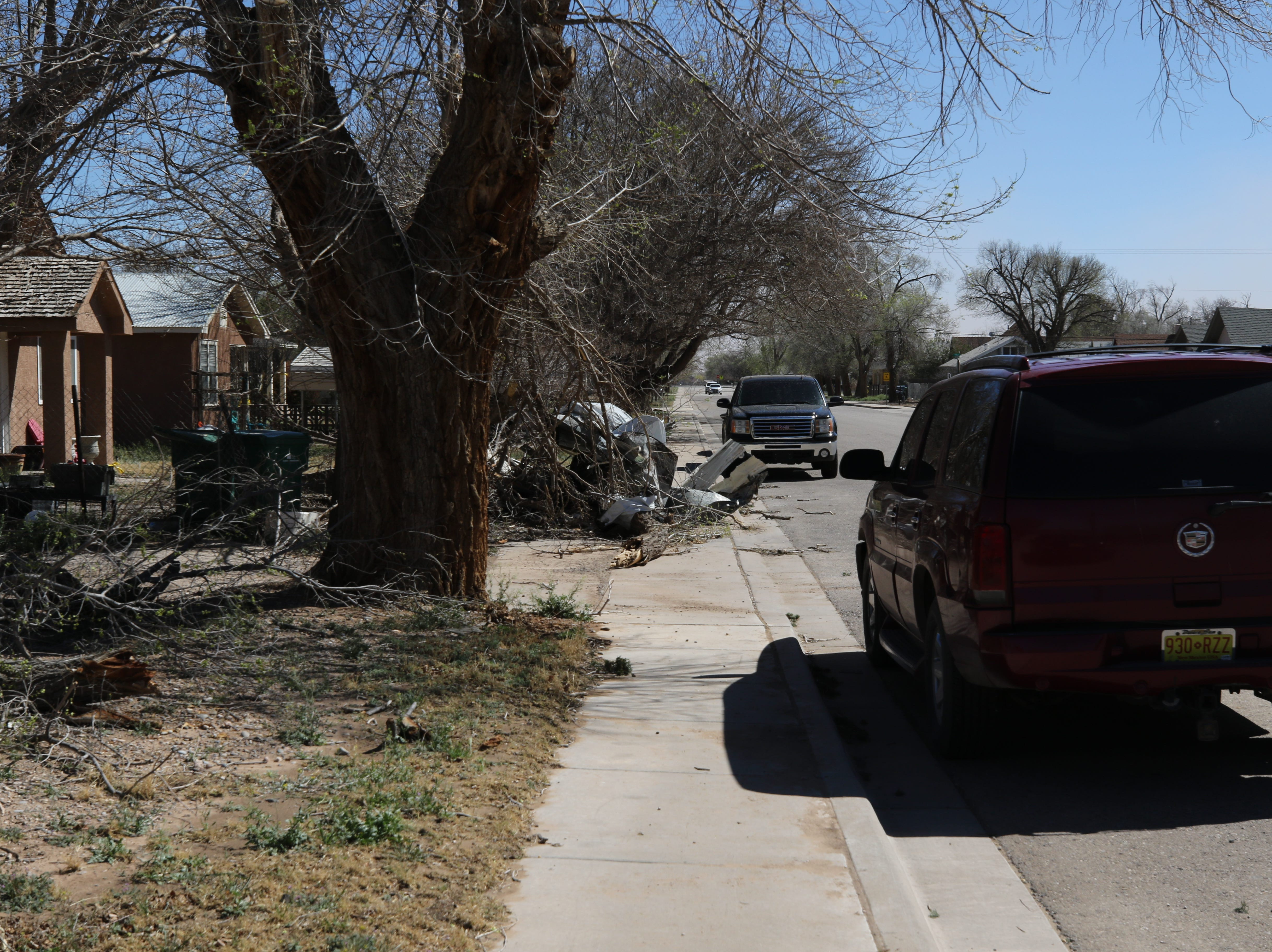Debris and downed limbs affected a Dexter, New Mexico neighborhood after a tornado struck the farming community Tuesday.