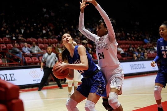 Carlsbad's Morgan Boatwright looks to put up a shot against Hobbs' Ayanna Smith during Thursday's 5A state semifinals at Dreamstyle Arena in Albuquerque.