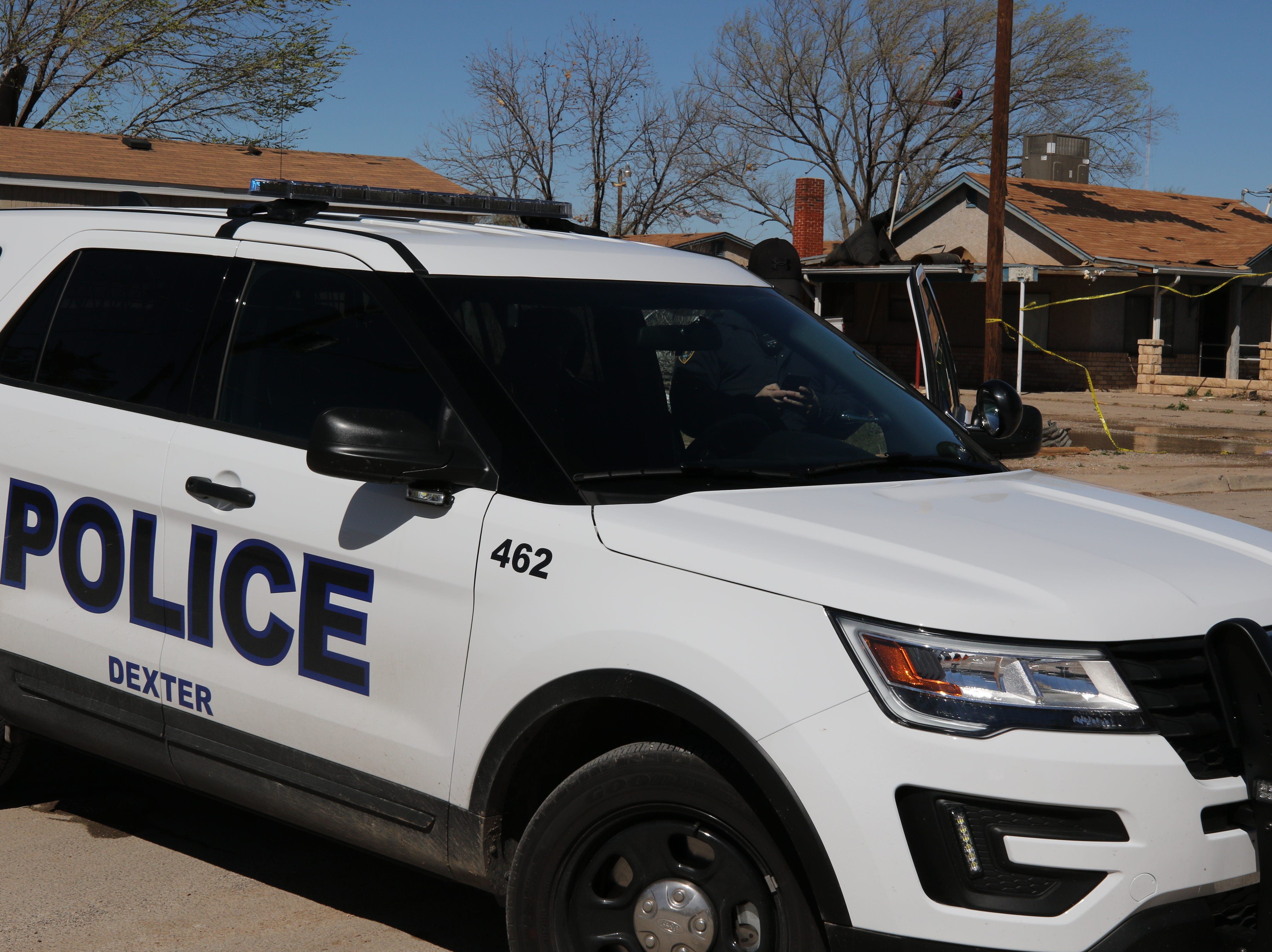 A Dexter, New Mexico police unit blocks off a neighborhood in the southern Chaves County farming community Wednesday. Crews were cleaning up neighborhoods struck by a tornado Tuesday.