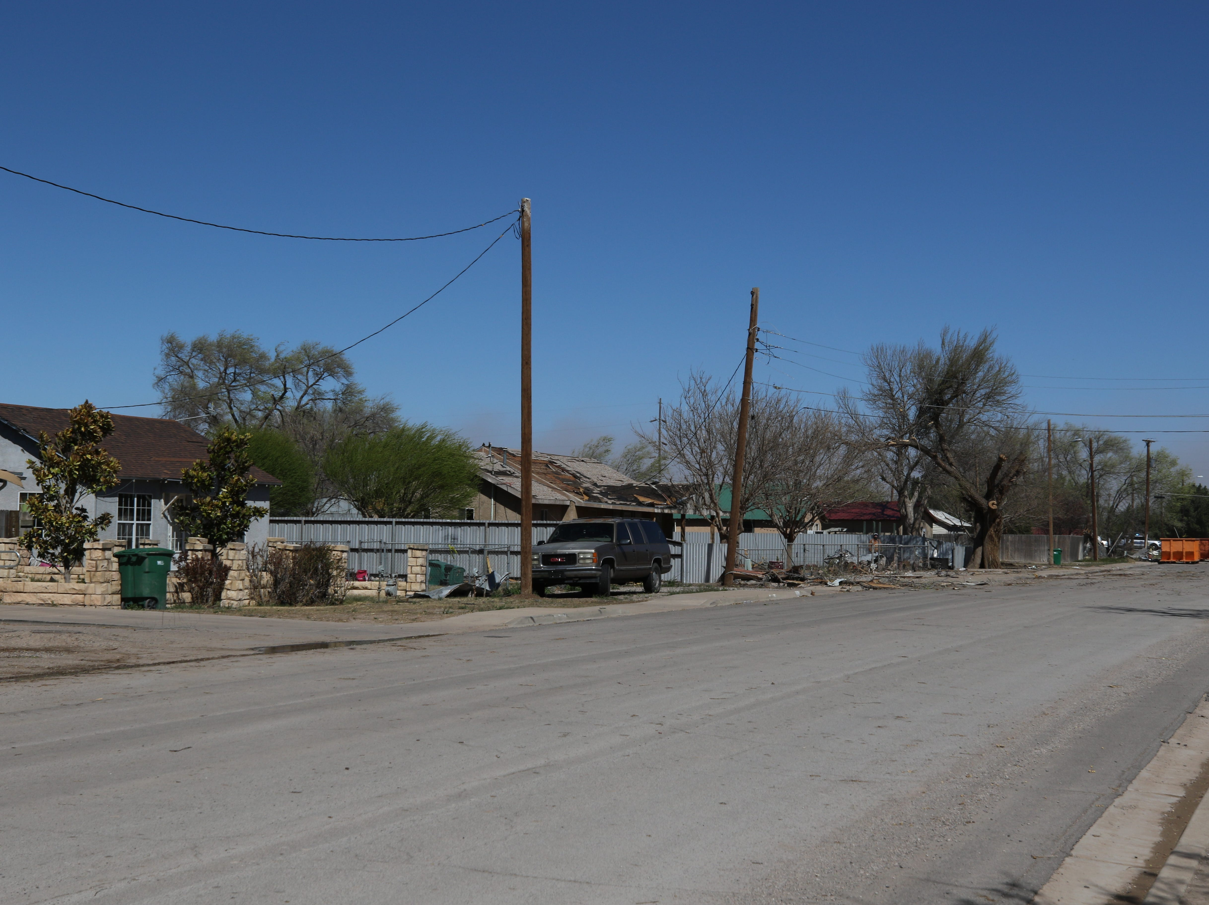 Houses in a Dexter,New Mexico neighborhood suffered damage from a tornado that struck Tuesday.