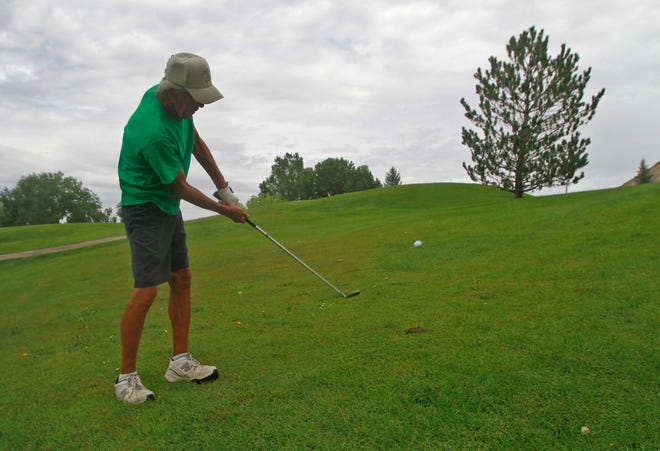 Pete McKinnon hits his ball, Thursday, Aug. 18, 2016 during a golf game at Aztec Municipal Golf Course in this file photo. The course could close by the end of the year.