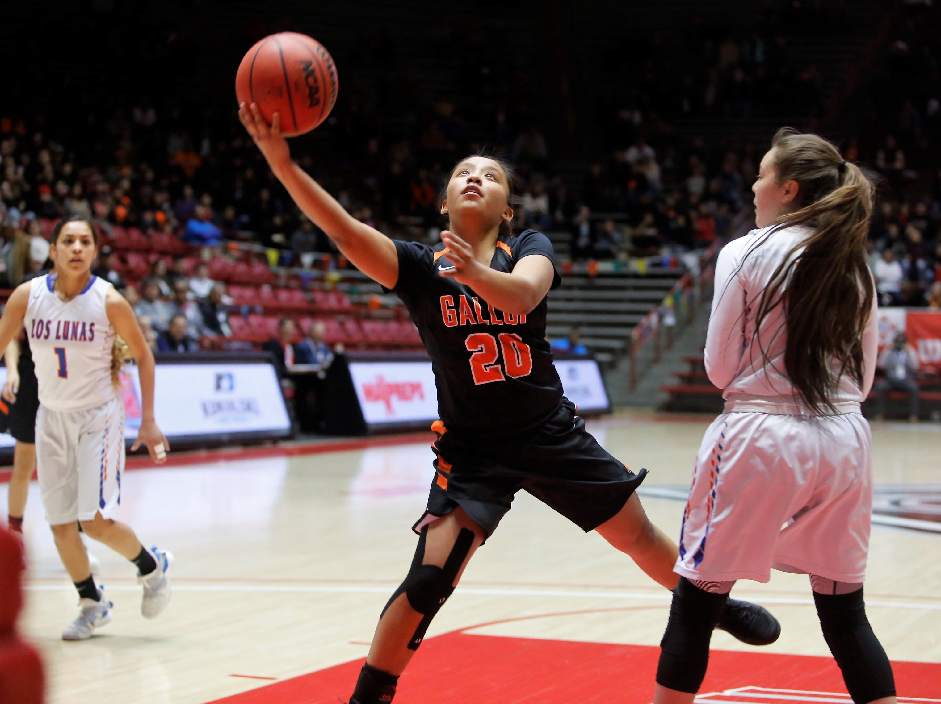 Gallup's Kamryn Yazzie drives in for an easy layup against Los Lunas during Thursday's 4A state semifinals at Dreamstyle Arena in Albuquerque.