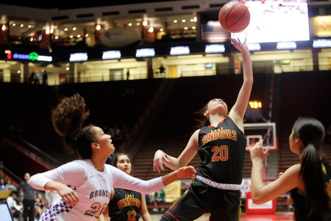 Española Valley's Destiny Valdez extends her left arm going for a defensive rebound against Kirtland Central during Thursday's 4A state semifinals at Dreamstyle Arena in Albuquerque.