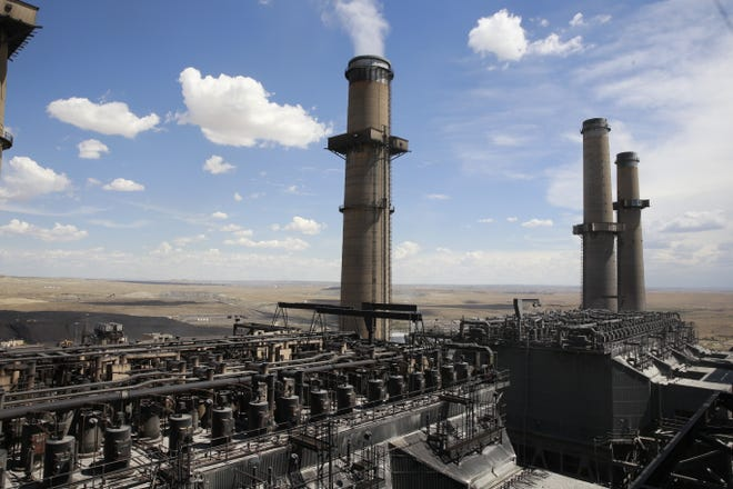 The San Juan Generating Station in Waterflow, seen in this 2015 file photo, is the subject of a feasibility study to assess the viability of installing carbon capture technology on two of its units.