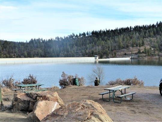 A hardy fisherman braves cold winter temperatures at Grindstone Lake.