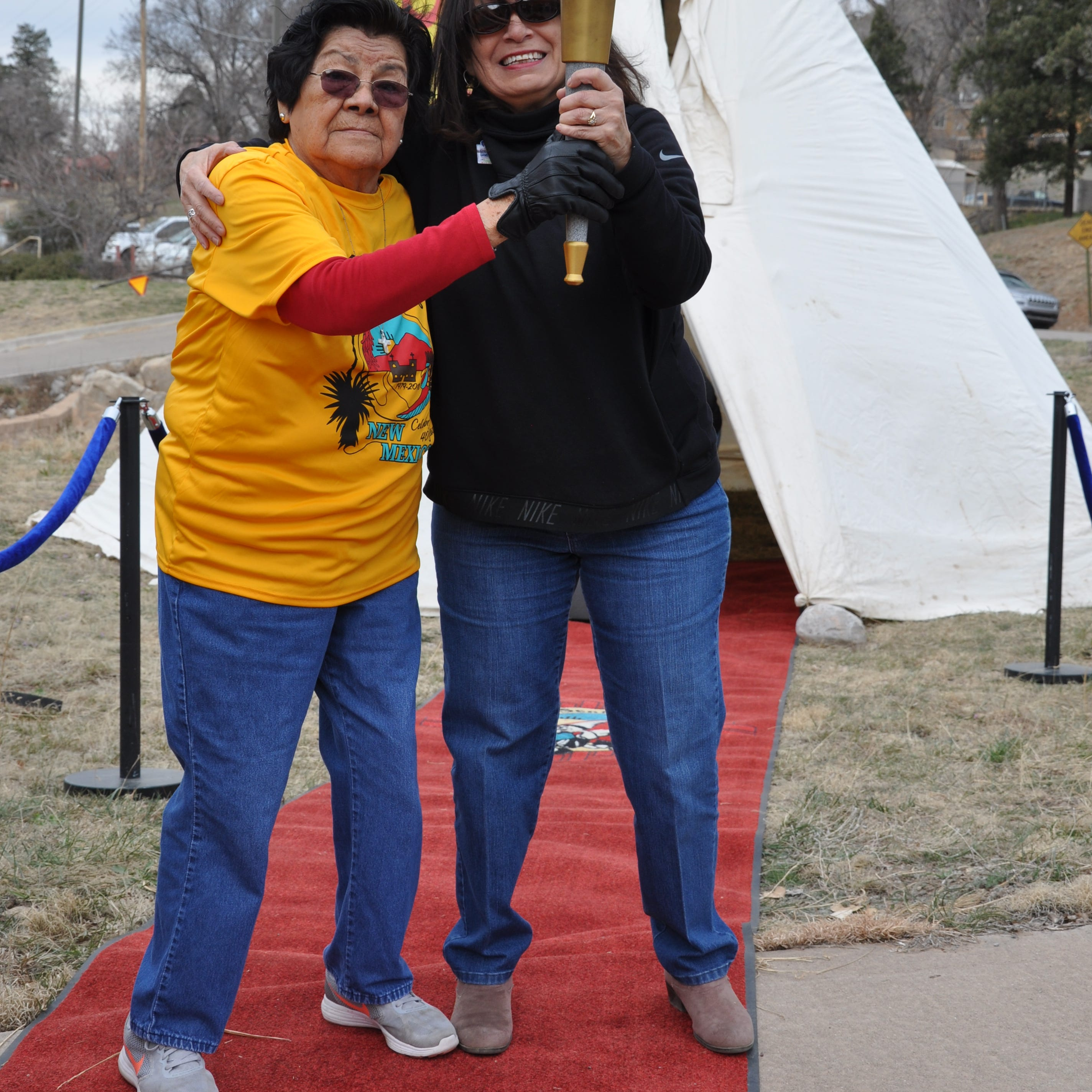 The passing of the torch relay at the Elderly Center in Mescalero.