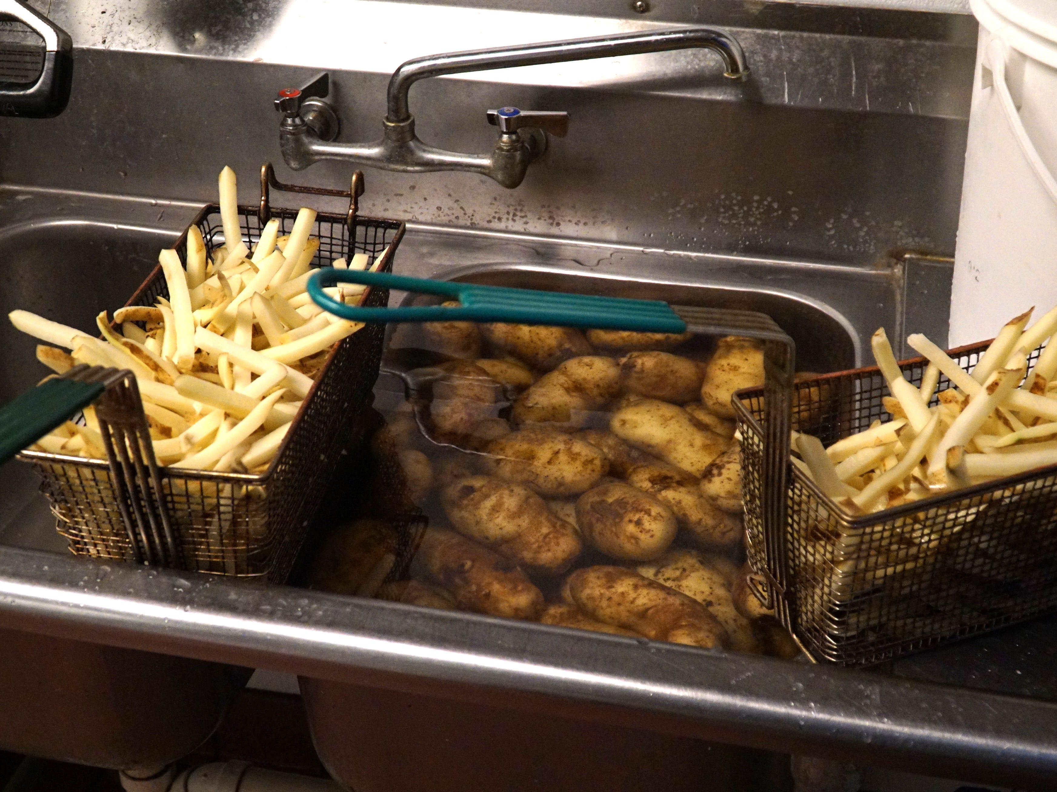 The Burger Joint makes it known that it hand-cuts all of its own fries.