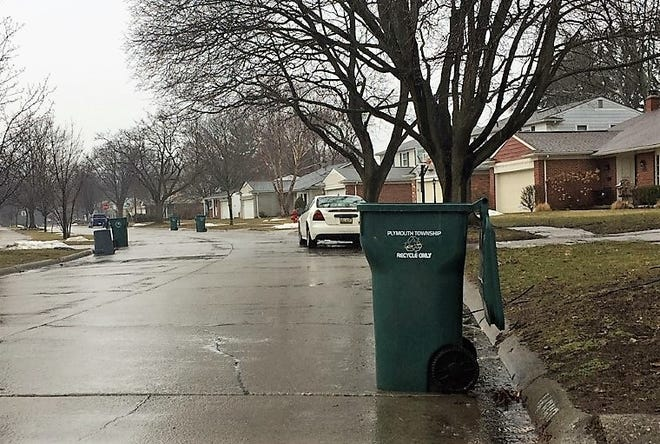 Empty recycling bins line Farmbrook Street in Plymouth Township Thursday afternoon.