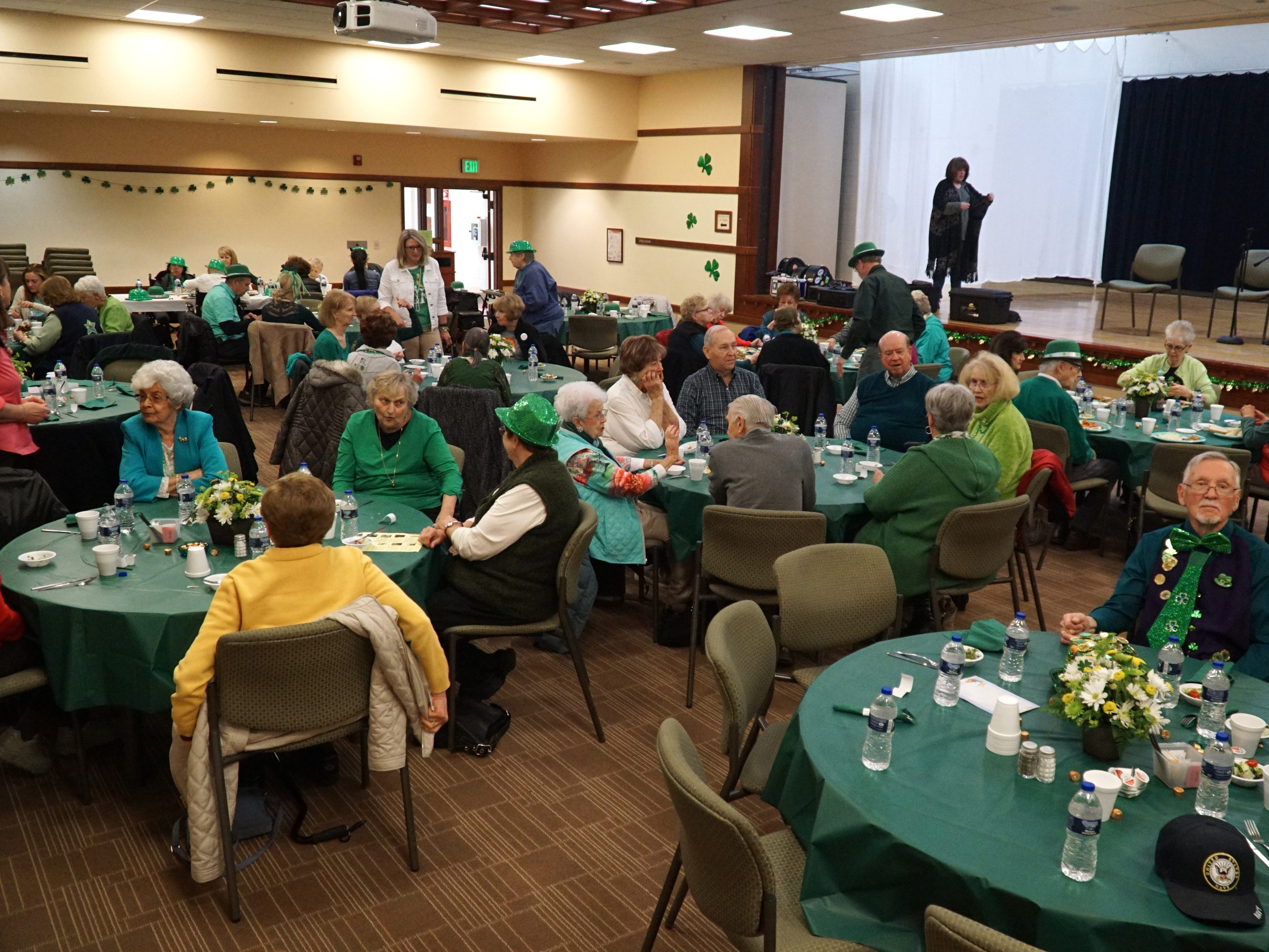 About 80 seniors gathered for the Community Center's St. Patrick's Day luncheon on March 14.