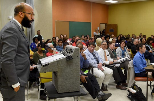 Louisiana Association of Educators representative Jamal Taylor speaks in front of a packed audience at Wednesday's meeting.