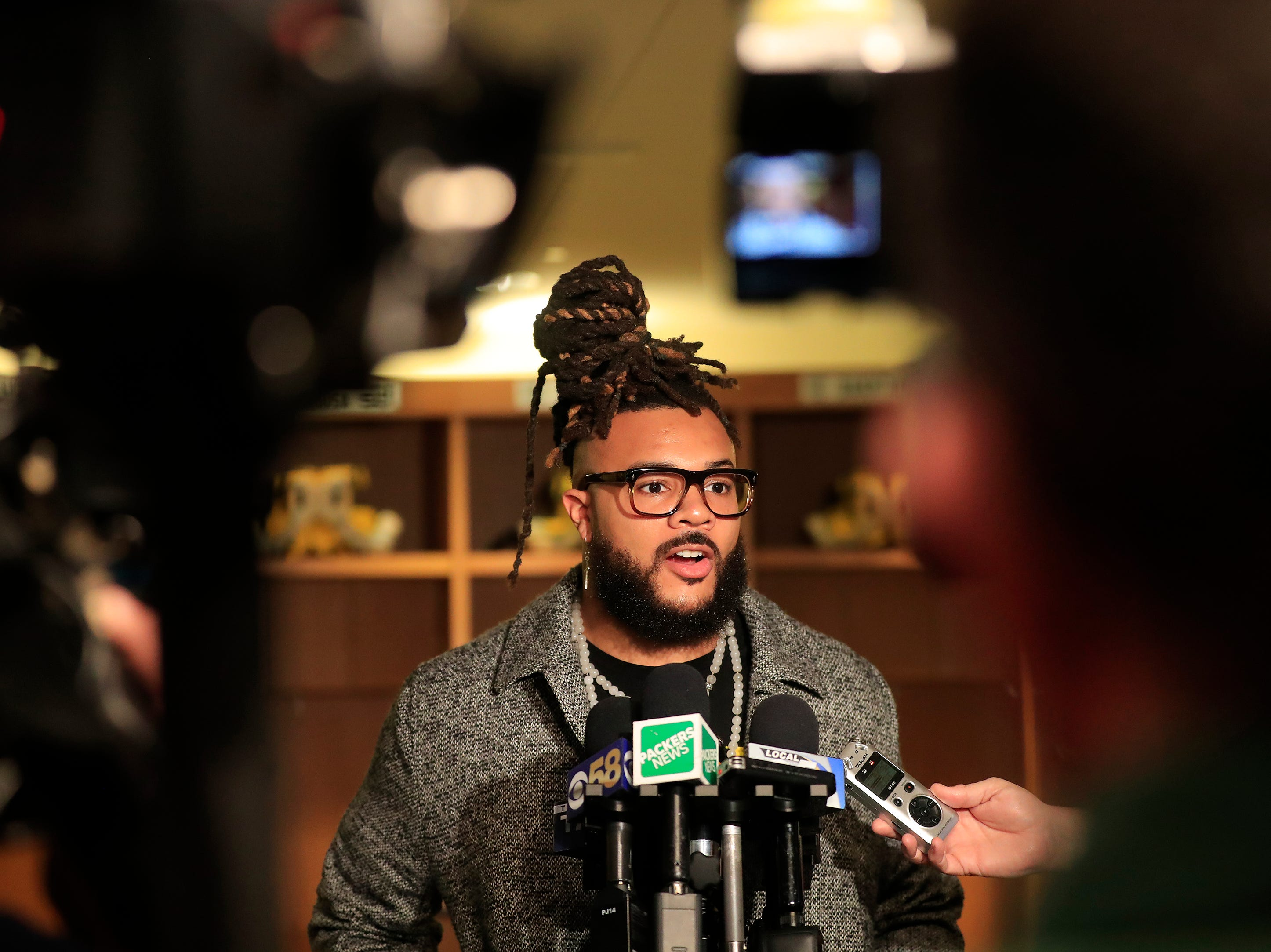 Green Bay Packers lineman Billy Turner talks to members of the media at Lambeau Field on Thursday, March 14, 2019 in Green Bay, Wis.