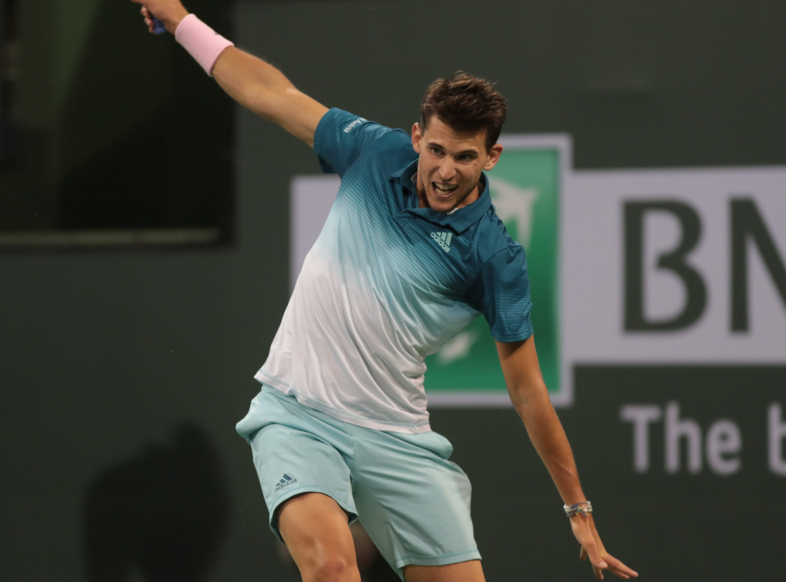 Dominic Thiem hits a backhand to Ivo Karlovic at the BNP Paribas Open in Indian Wells, Calif., March 13, 2019.