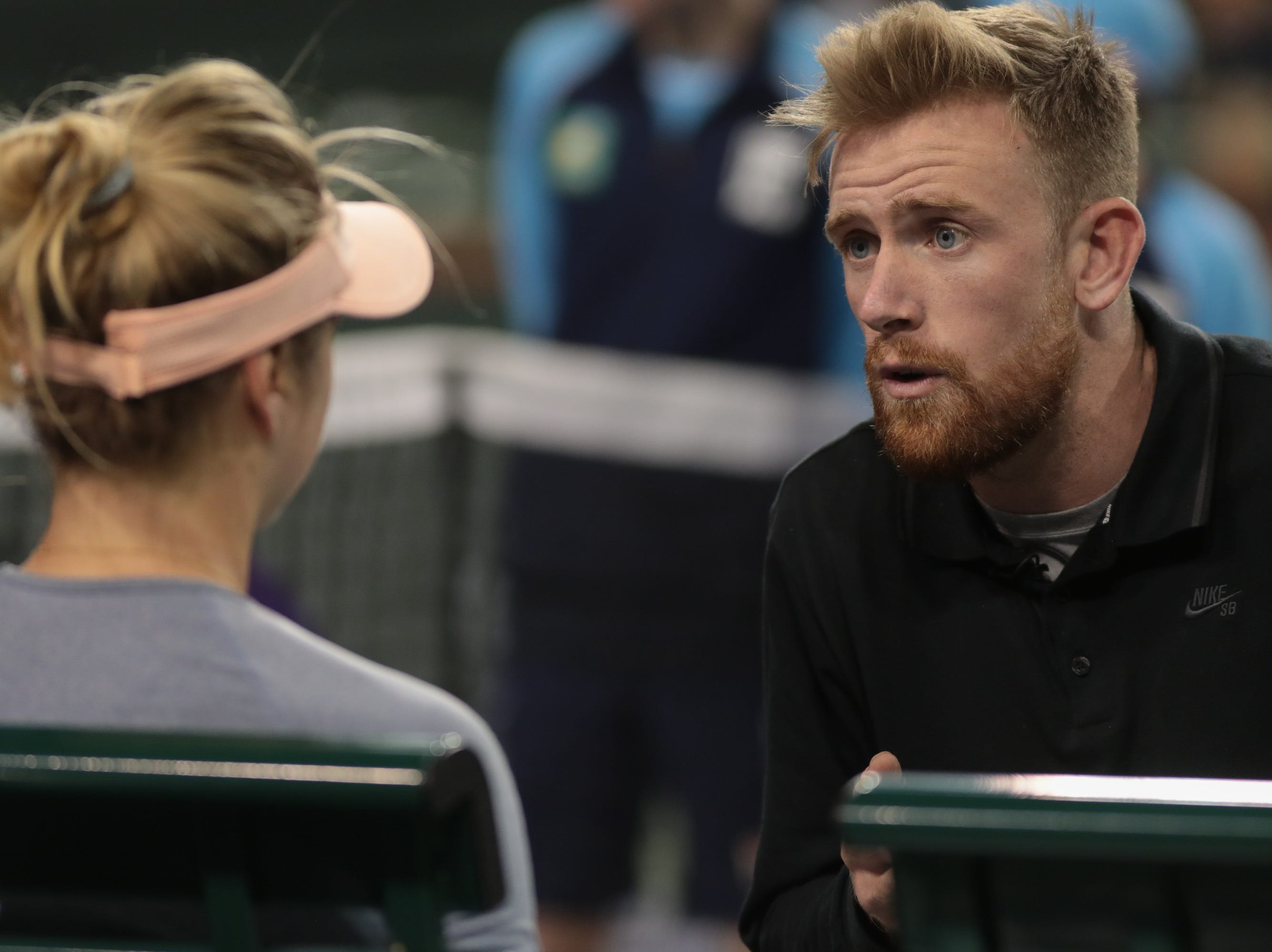 Elina Svitolina talks to her couch Andrew Bettles during her match against Marketa Vondrousova at the BNP Paribas Open in Indian Wells, Calif., March 13, 2019.