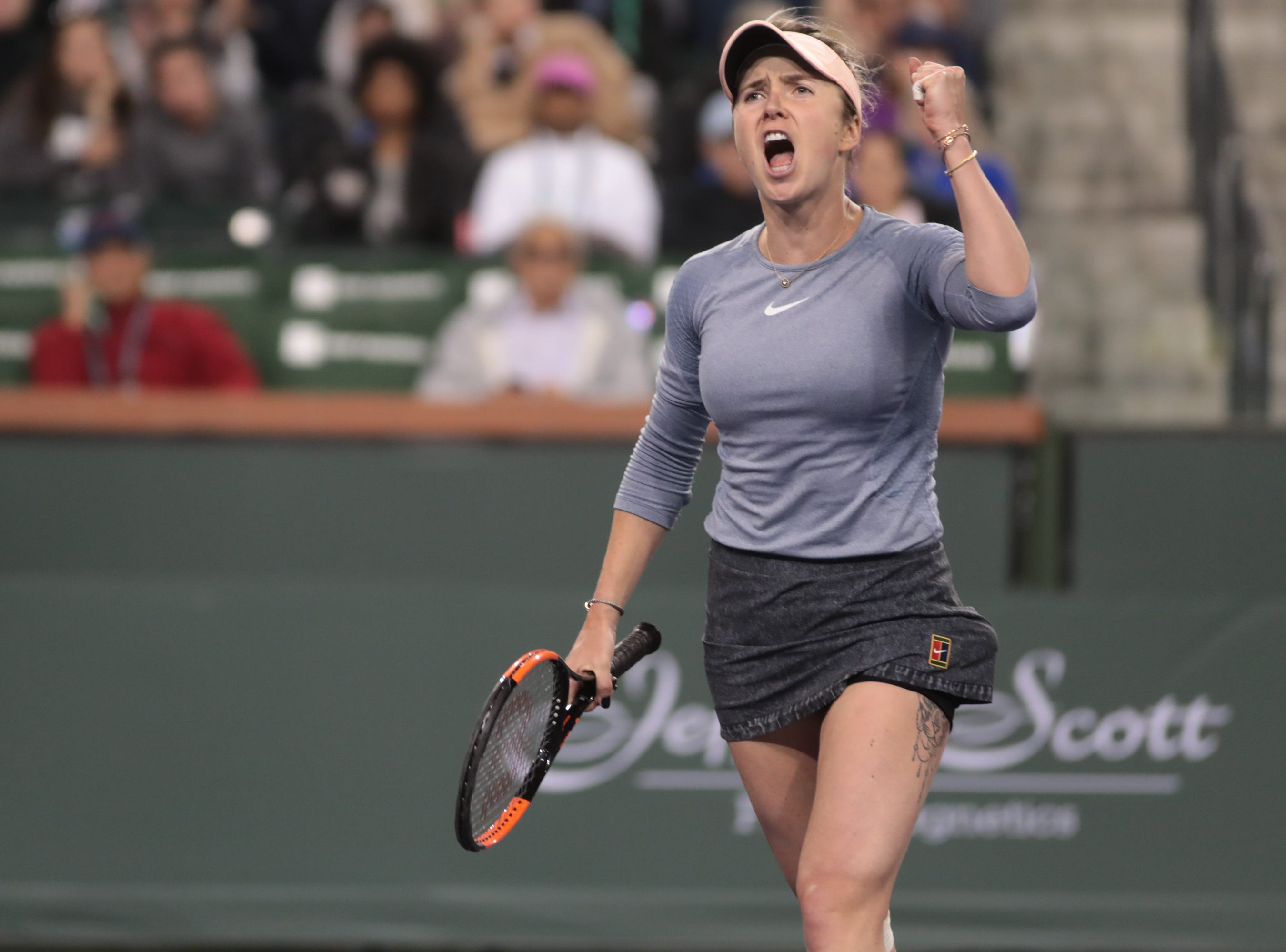 Elina Svitolina reacts after a point in the third set of her match against Marketa Vondrousova at the BNP Paribas Open in Indian Wells, Calif., March 13, 2019.
