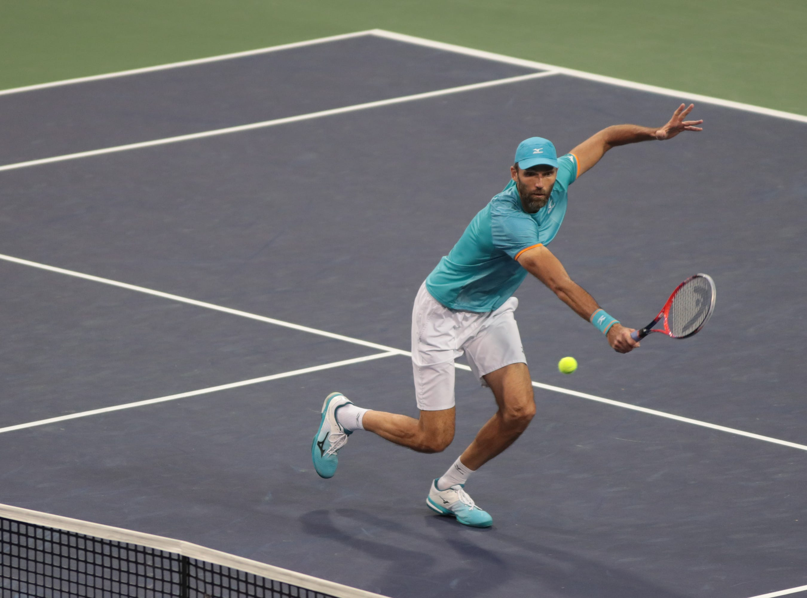 Ivo Karlovic volleys to Dominc Thiem at the BNP Paribas Open in Indian Wells, Calif., March 13, 2019. At 40, Karlovic was the