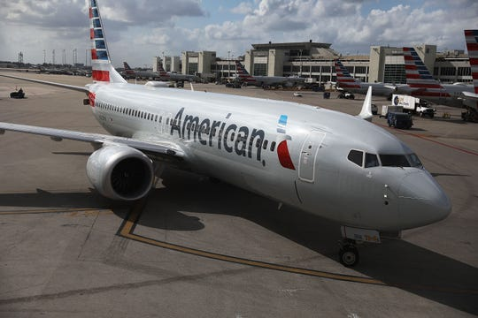 MIAMI, FLORIDA - MARCH 13: An American Airlines Boeing 737 Max 8 is seen as it pulls into its gate after arriving at the Miami International Airport from LaGuardia Airport on March 13, 2019 in Miami, Florida. American Airlines is reported to say that it will ground its fleet of 24 Boeing 737 Max planes and it plans to rebook passengers after the Federal Aviation Administration grounded the entire United States Boeing 737 MAX fleet. (Photo by Joe Raedle/Getty Images)