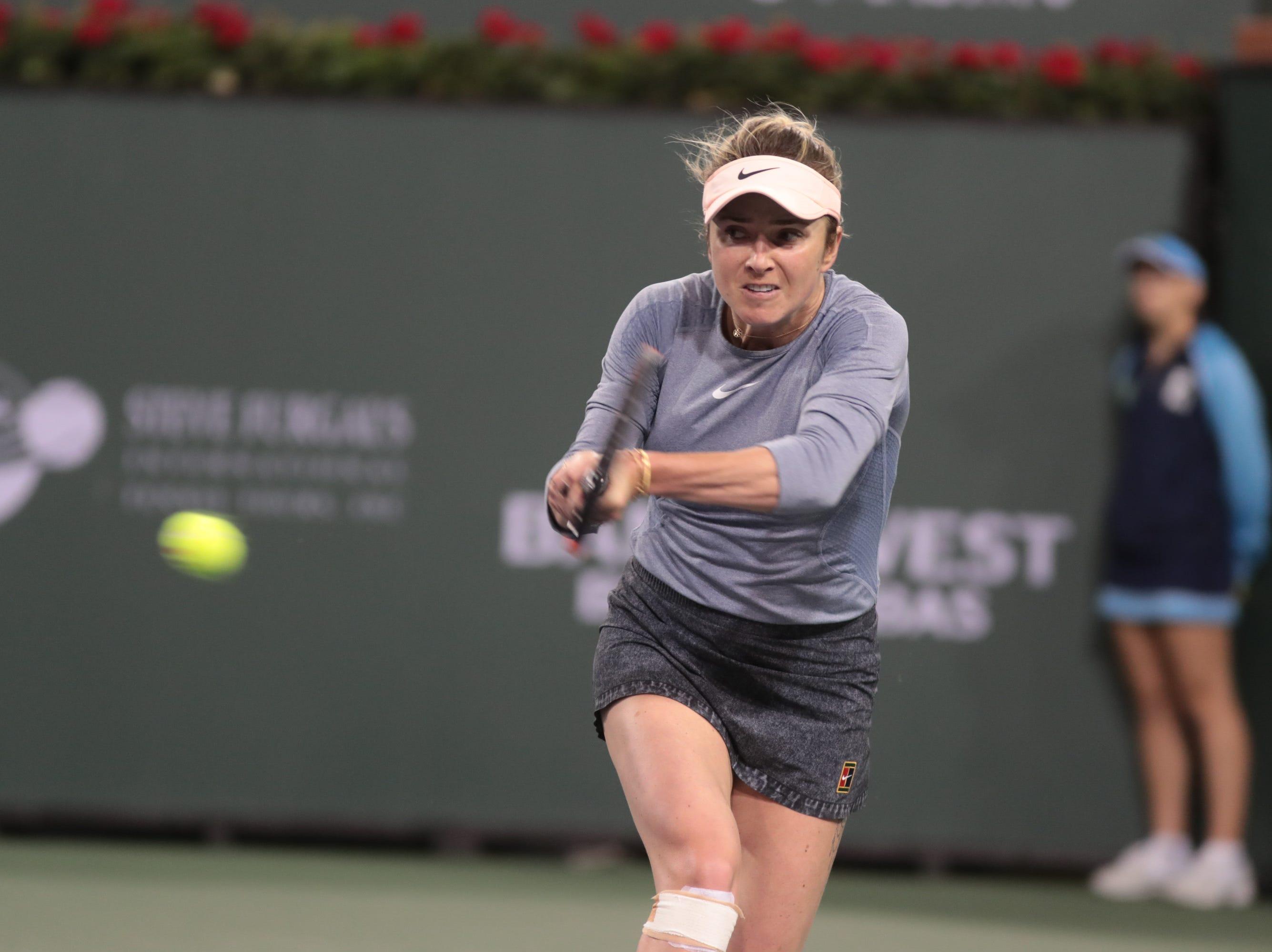 Elina Svitolina hits a backhand to Marketa Vondrousova at the BNP Paribas Open in Indian Wells, Calif., March 13, 2019.