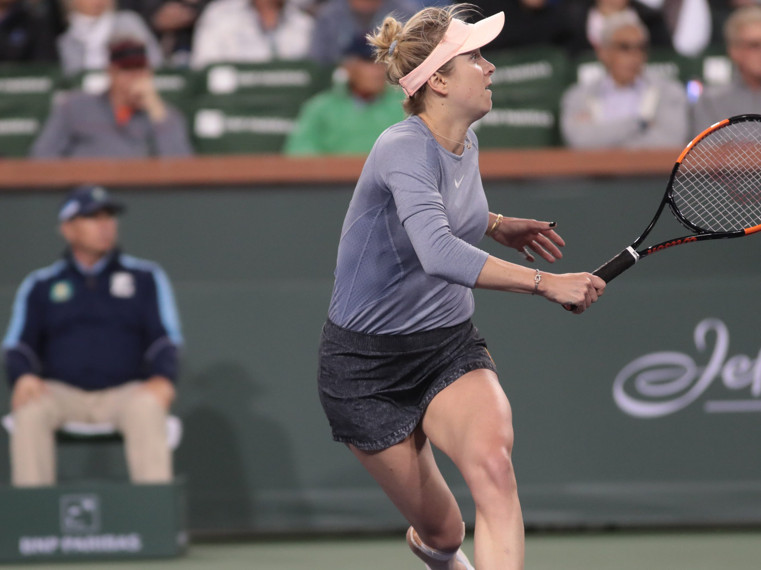 Elina Svitolina runs to a shot from Marketa Vondrousova in the third set of their match at the BNP Paribas Open in Indian Wells, Calif., March 13, 2019.