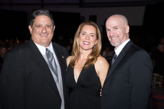 Palm Springs Air Museum Managing Director Fred Bell with Lisa and Jim Houston Jr.