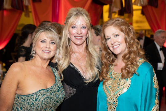 Palm Springs Air Museum Gala Co-Chairs (l-r) Lisa Bell, Marguerita Maassen-Gilbertson and Linsey Moore Vandenbos.