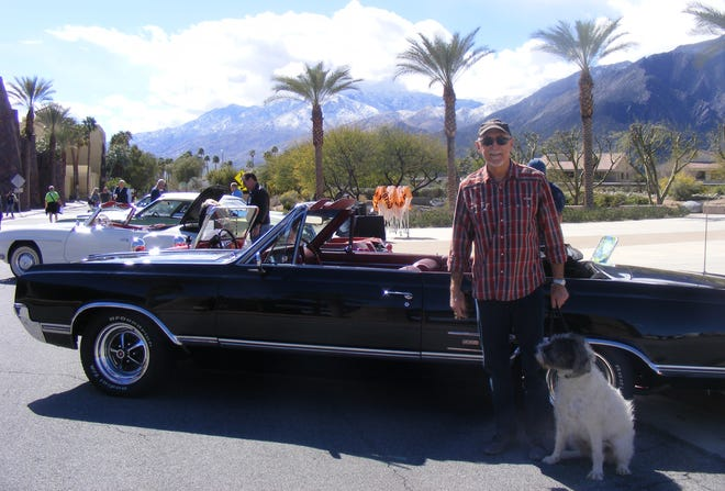 Two very different rescues – a vintage car from the dump and a rescue dog from the pound.