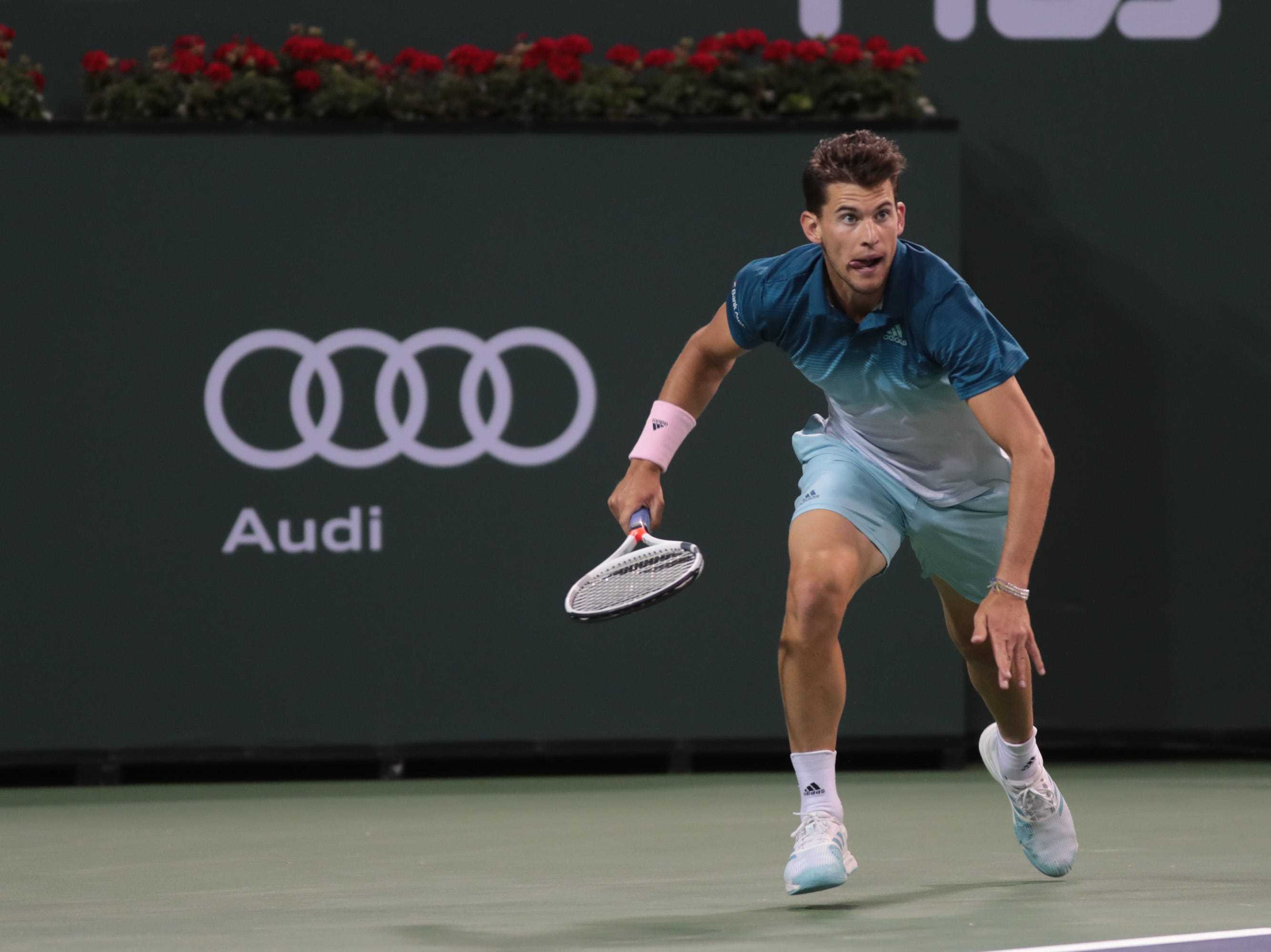 Dominic Thiem runs to a shot from Ivo Karlovic at the BNP Paribas Open in Indian Wells, Calif., March 13, 2019.