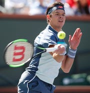 Milos Raonic attacks a ball during his game against Miomir Kecmanovic on Stadium One at the 2019 BNP Paribas Open at Indian Wells Tennis Garden on March 12, 2019. Raonic won the quarterfinal match 6-3, 6-4.