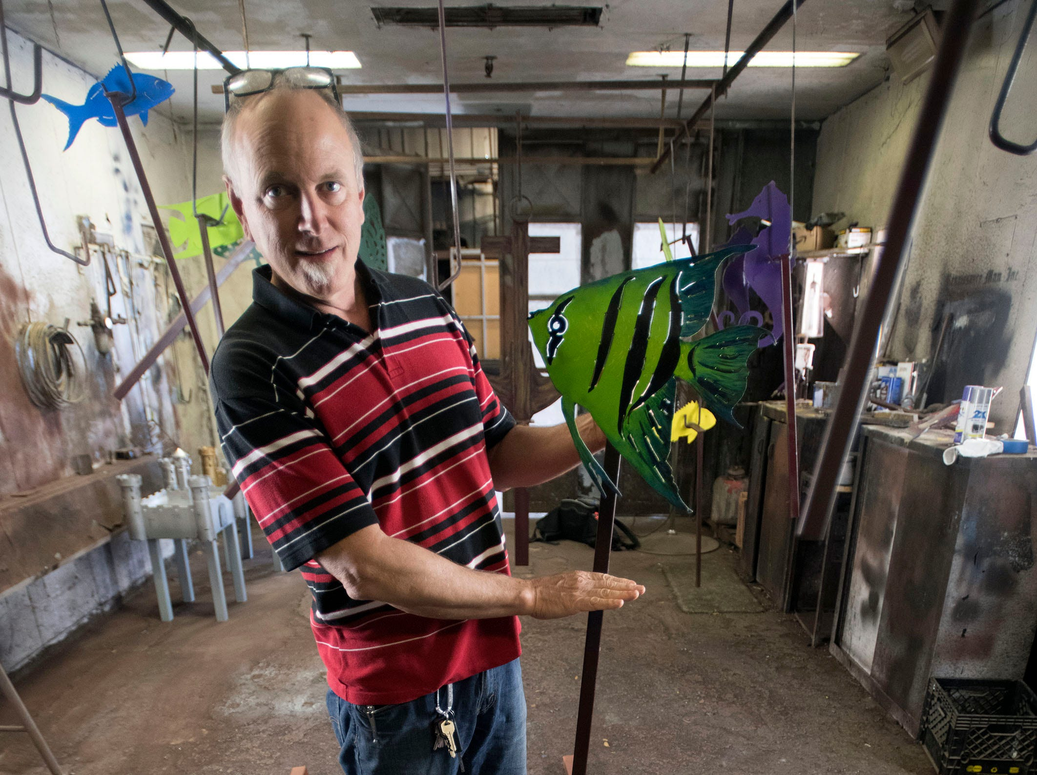 Kevin Marchetti, the owners of Renaissance Man, Inc., is putting the finishing touches on his latest creations before sending them off The Studer Family Children's Hospital at Sacred Heart on Wednesday, March 13, 2019. The metal sculptures and artwork will be on display in one of the new gardens at the hospital.