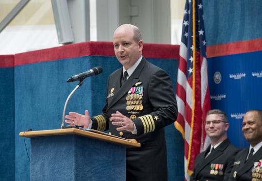 Capt. Timothy Kinsella, the new commander of Naval Air Station Pensacola, speaks Thursday during the change of command ceremony at the National Naval Aviation Museum.