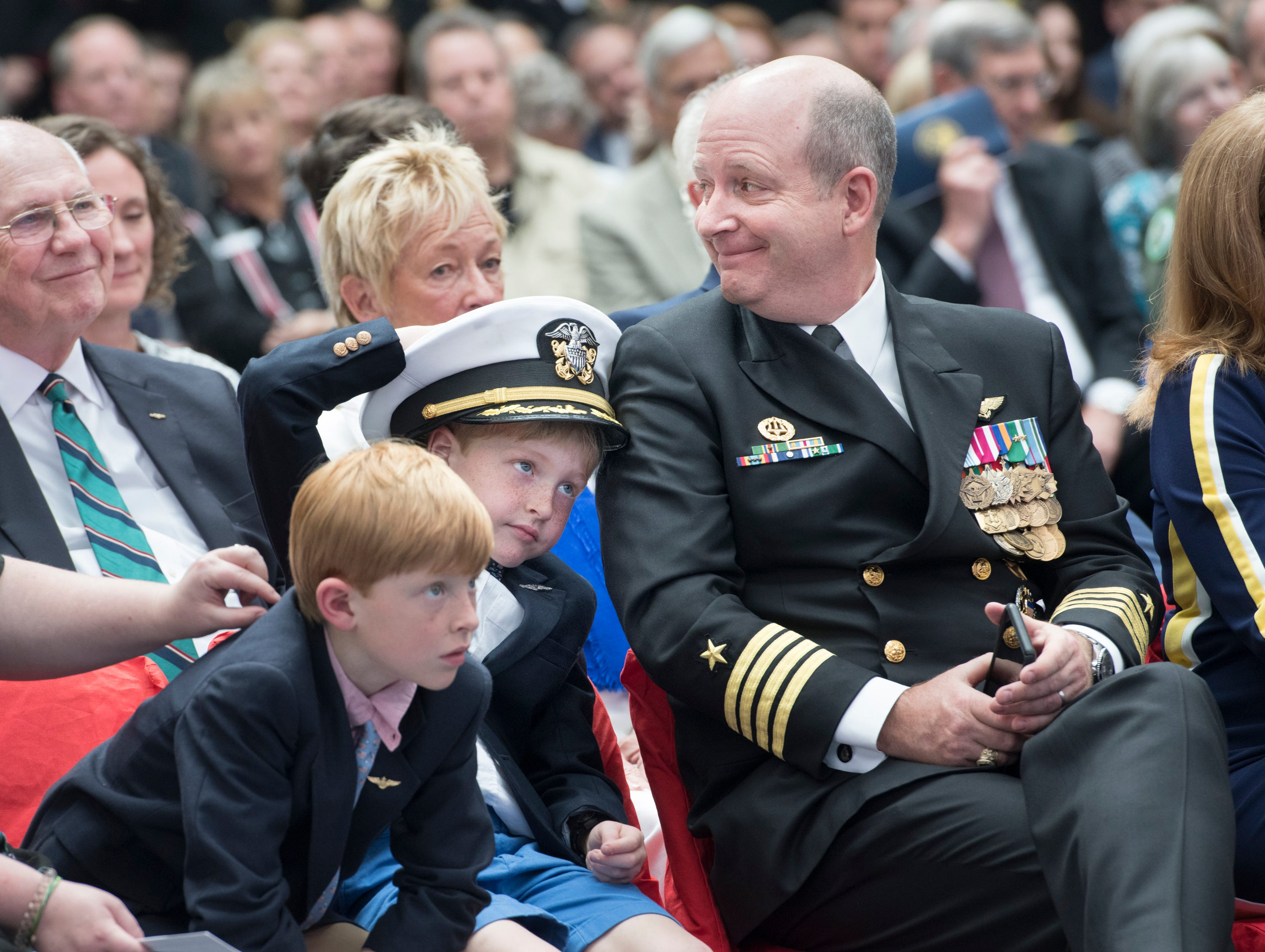 New base commander Capt. Timothy Kinsella, Jr. and family listen during the change of command ceremony at the National Naval Aviation Museum at Naval Air Station Pensacola on Thursday, March 14, 2019.