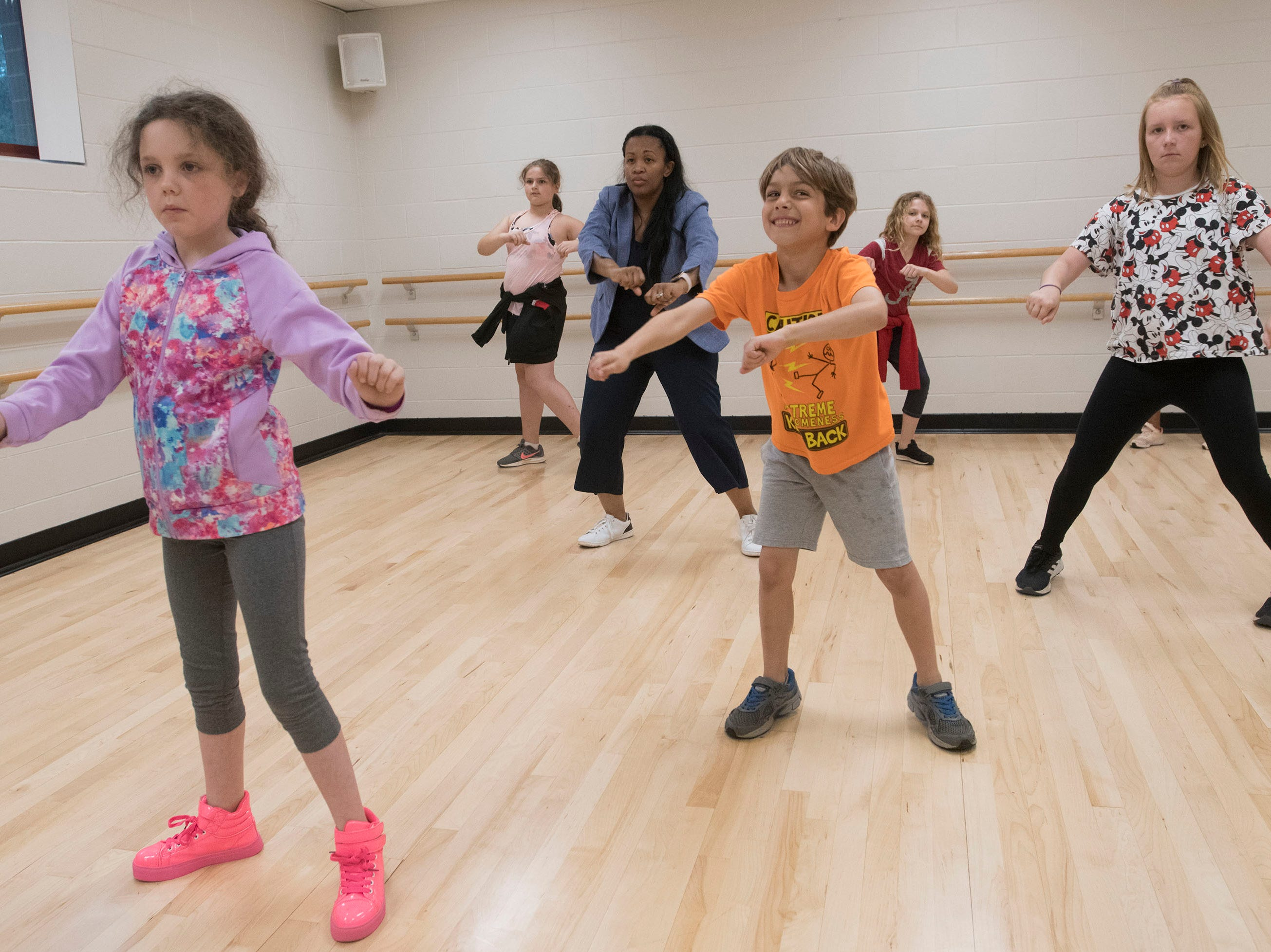Joy Gainer teaches a group of kids a few hip hop dance moves during a class at the Gull Point Community Center on Spanish Trail on Wednesday, March 13, 2019.