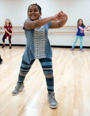 Janelle Williams, 6, shows off some of her new hip hop dance skills during classes at the Gull Point Community Center on Wednesday, March 13, 2019.