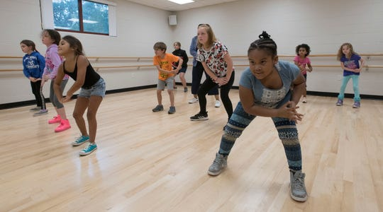 Children show off their new hip hop dance moves during class at Gull Point Community Center on Spanish Trail on Wednesday, March 13, 2019.