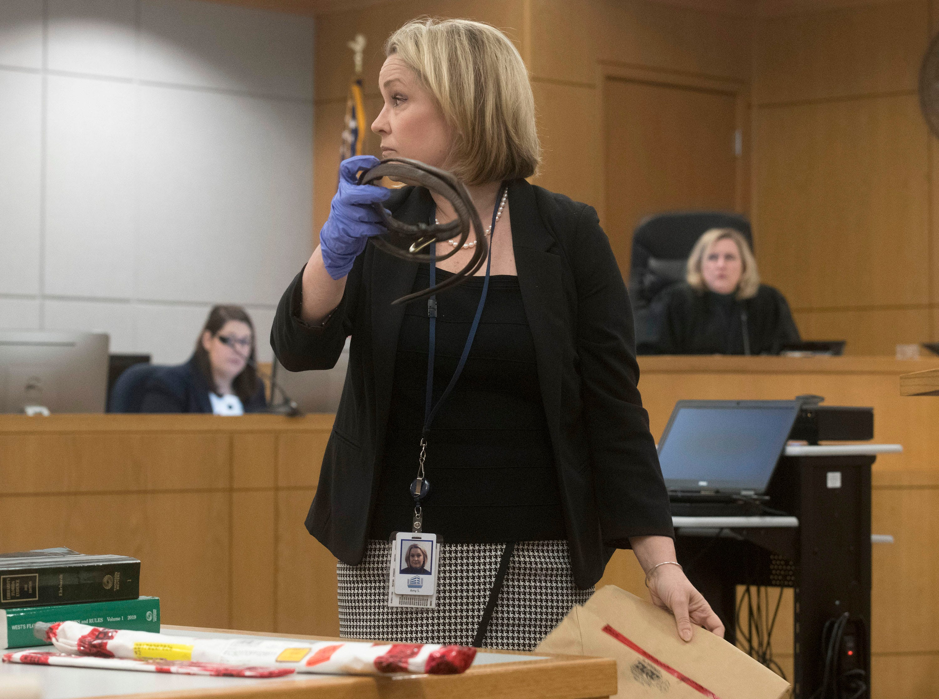 Assistant State Attorney Amy Shea shows off a piece of evidence during the trial of Veronica Green Posey on Thursday, March 14, 2019.  Posey is on trial for the death of her 9-year-old cousin Dericka Lindsay.