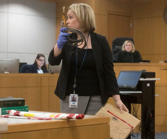 Assistant State Attorney Amy Shea shows a piece of evidence during the trial of Veronica Green Posey on Thursday.