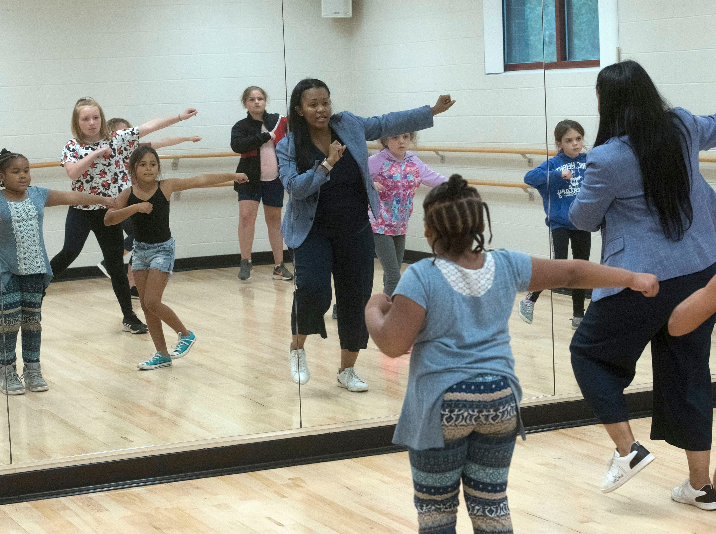 Joy Gainer teachs a group of kids a few hip hop dance moves during a class at the Gull Point Community Center on Spanish Trail on Wednesday, March 13, 2019.
