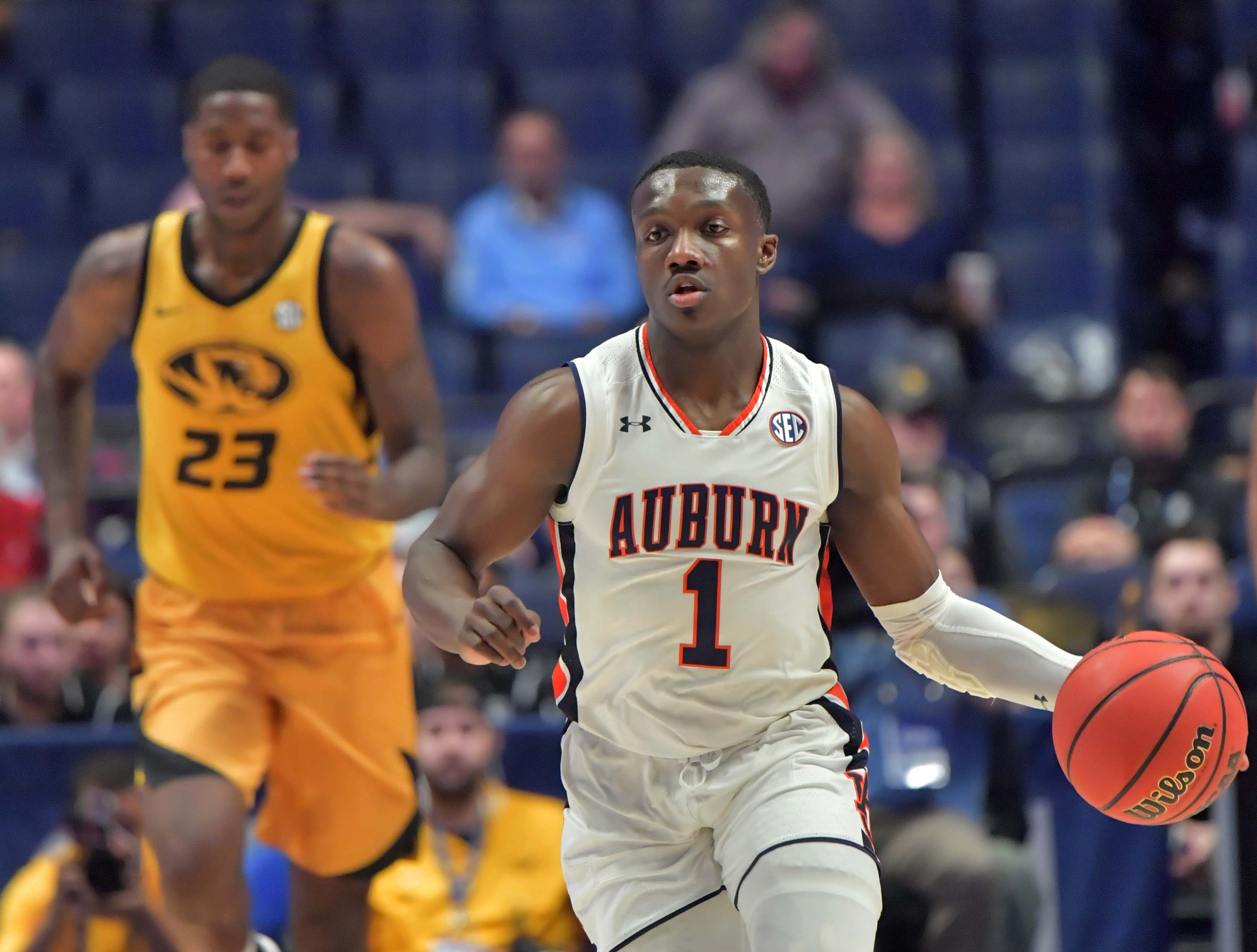 Mar 14, 2019; Nashville, TN, USA; Auburn Tigers guard Jared Harper (1) dribbles the ball against the Missouri Tigers in the SEC conference tournament at Bridgestone Arena. Mandatory Credit: Jim Brown-USA TODAY Sports