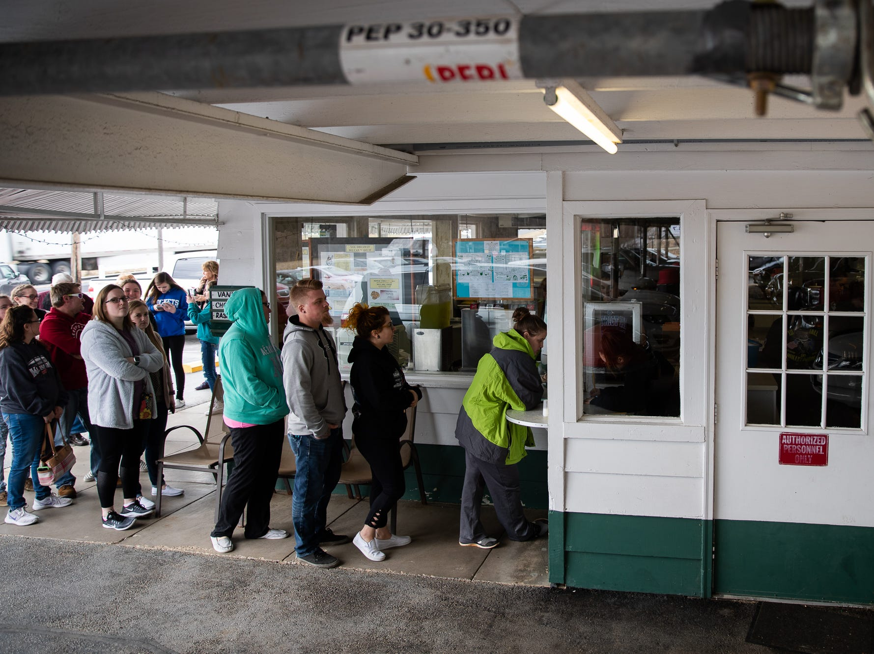 Customers line up to order during Tropical Treat's first day of business for the 2019 season, Wednesday, March 13, 2019, in Berwick Township.