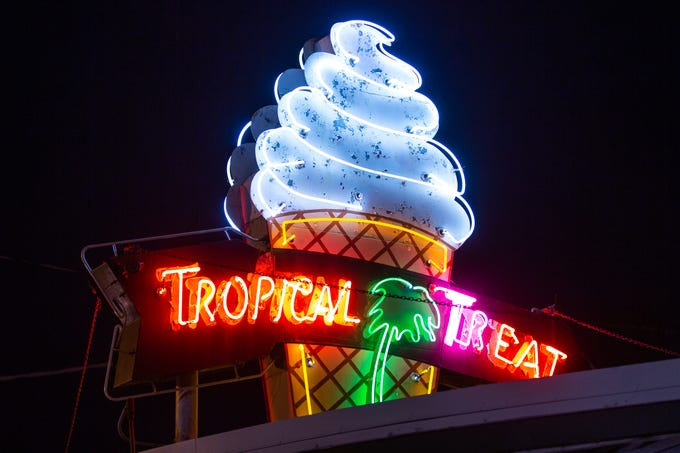 The iconic Tropical Treat neon sign lights up during Tropical Treat's first day of business for the 2019 season, Wednesday, March 13, 2019, in Berwick Township.