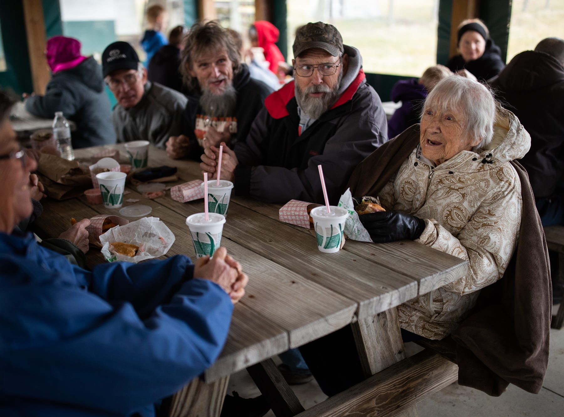 Geraldean Bain, 94, right, laughs while eating with Barb Manger, left, Sandy Yerger, out of frame, Lisa Homan, out of frame, Steve Manger, second from left, Randy Homan, third from left, and Steve Yerger, second from right, during Tropical Treat's first day of business for the 2019 season, Wednesday, March 13, 2019, in Berwick Township. The group has been coming to the opening day of the Tropical Treat for more than 40 years.