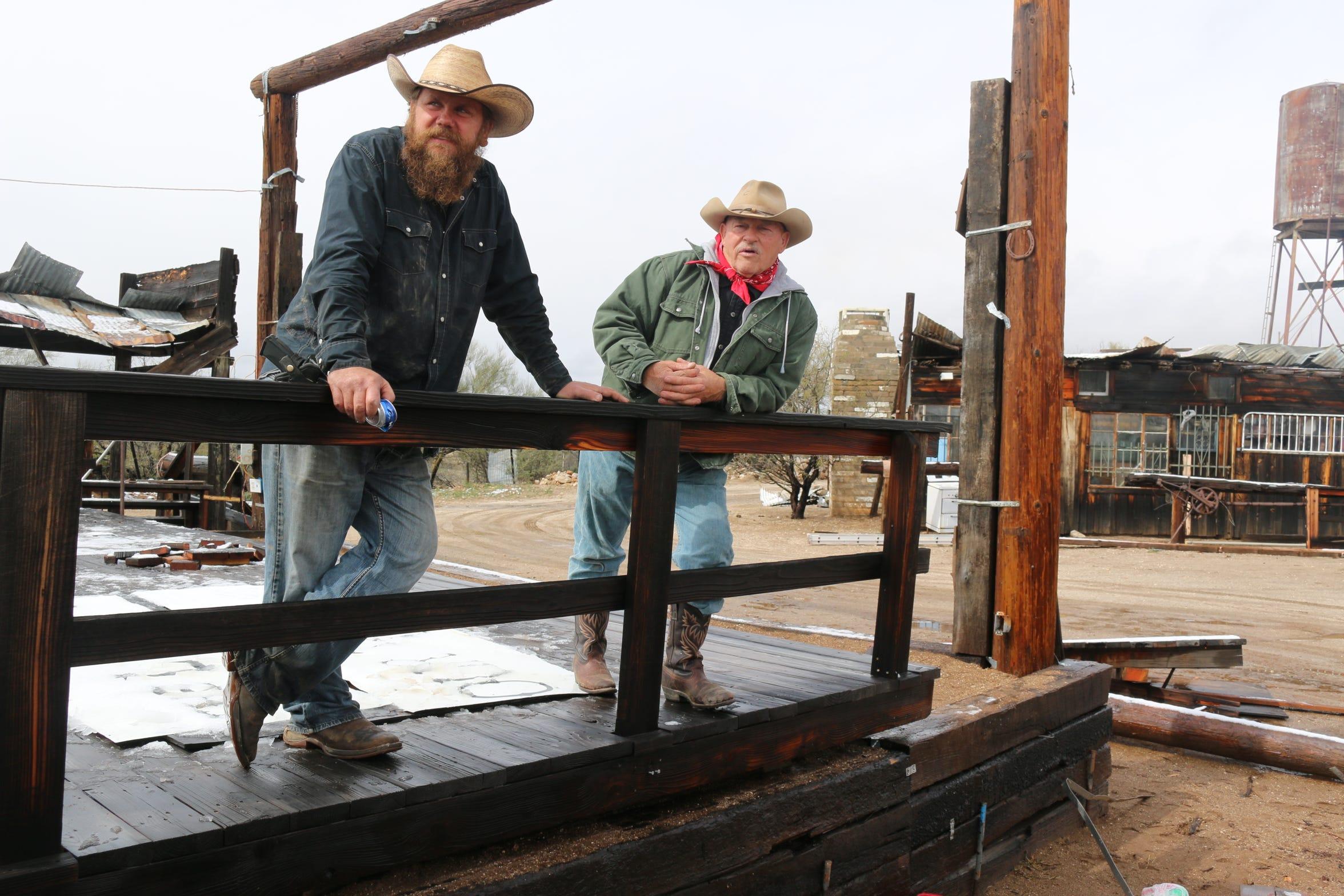 Dan Clark (left) and Larry Burt talk at Cowtown Keeylocko.