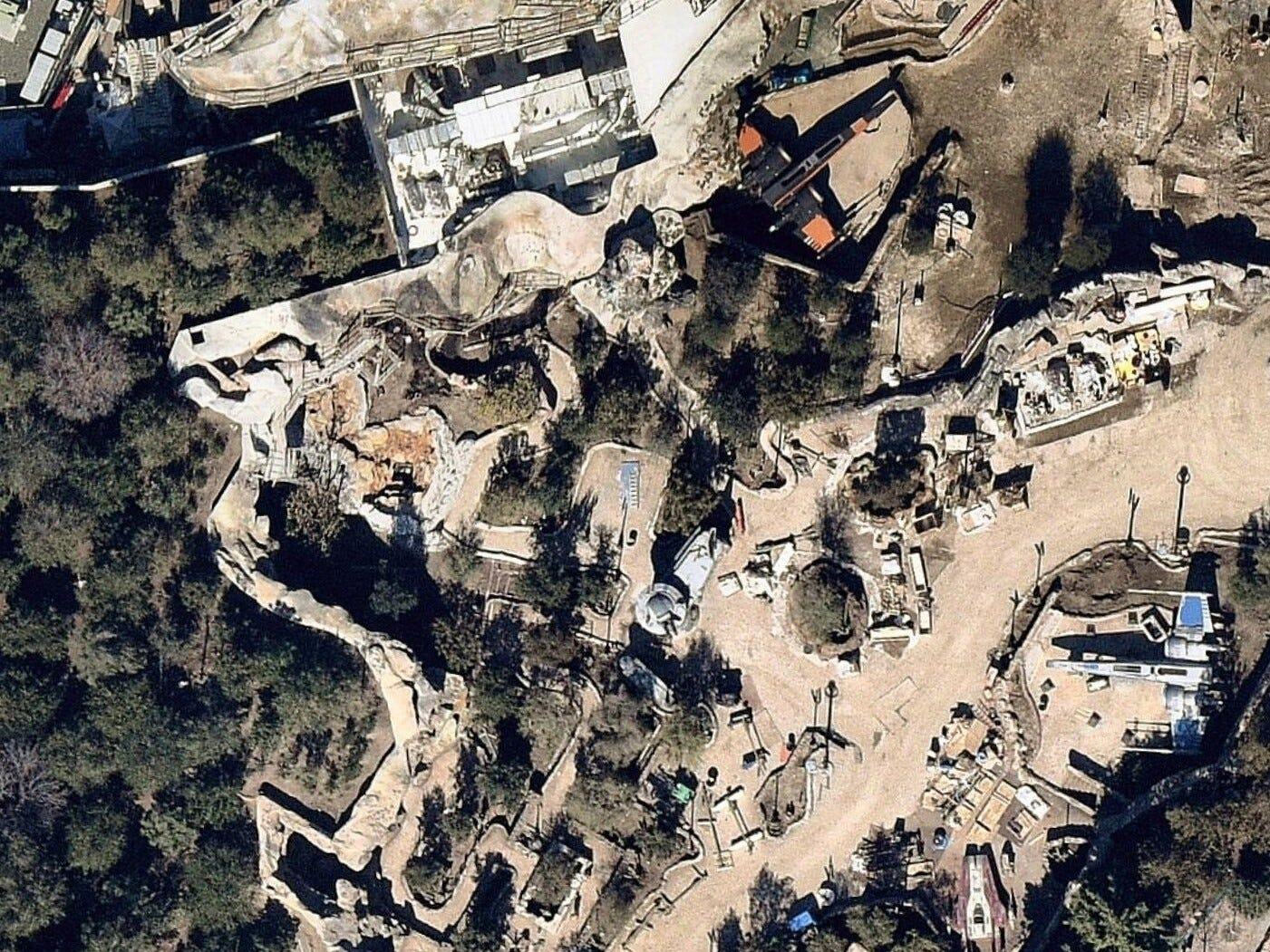 Note the sleek black X-Wing at the top, as well as the  blue-and-white X-Wing at the lower right parked near an A-Wing, iconic Star Wars fighters as seen in a February satellite image of Star Wars: Galaxy's Edge at Disneyland. A laser turret can be seen near the center.  The queue to Star Wars: Rise of the Resistance will thread through the caves and paths here. The land opens May 31, though Rise of the Resistance won't be ready until later this year.