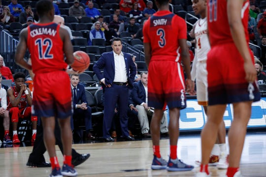 Arizona's head coach Sean Miller, center, looks toward the court during the first half of an NCAA college basketball game against Southern California in the first round of the Pac-12 conference tournament Wednesday, March 13, 2019, in Las Vegas.
