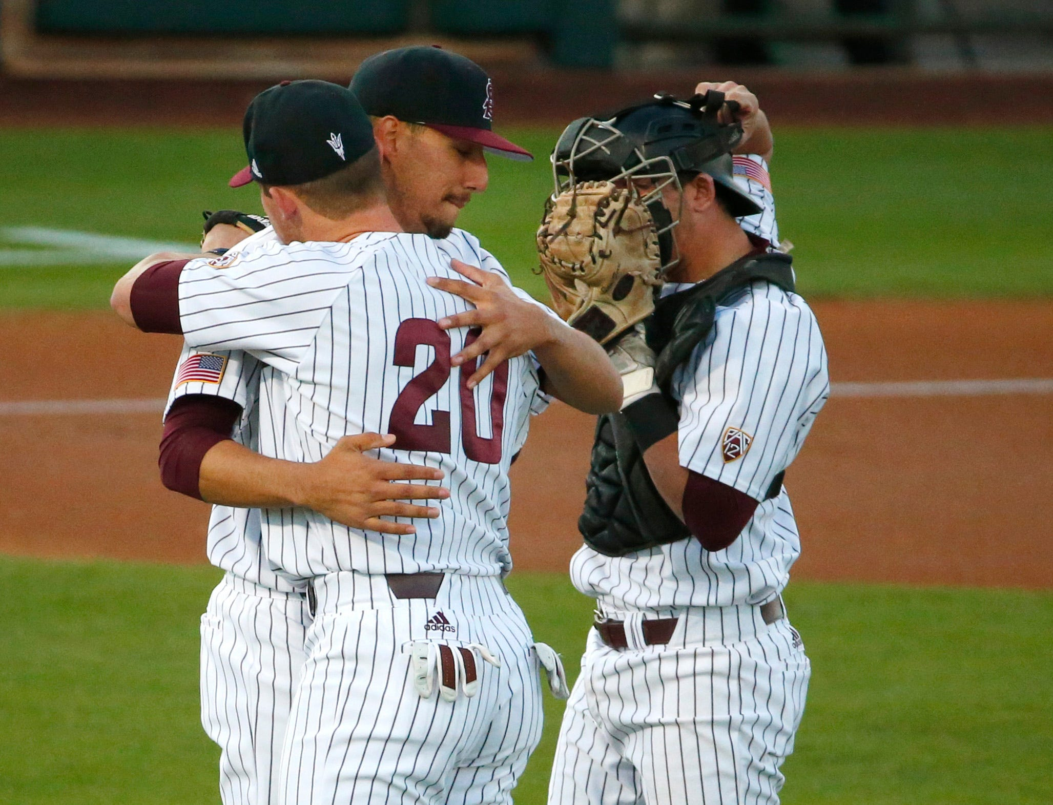 ASU RHP Sam Romero (26) gets a hug from first baseman Spencer Torkelson (20) before taking the mound during a baseball game against New Mexico at Phoenix Municipal Stadium on March 13, 2019.