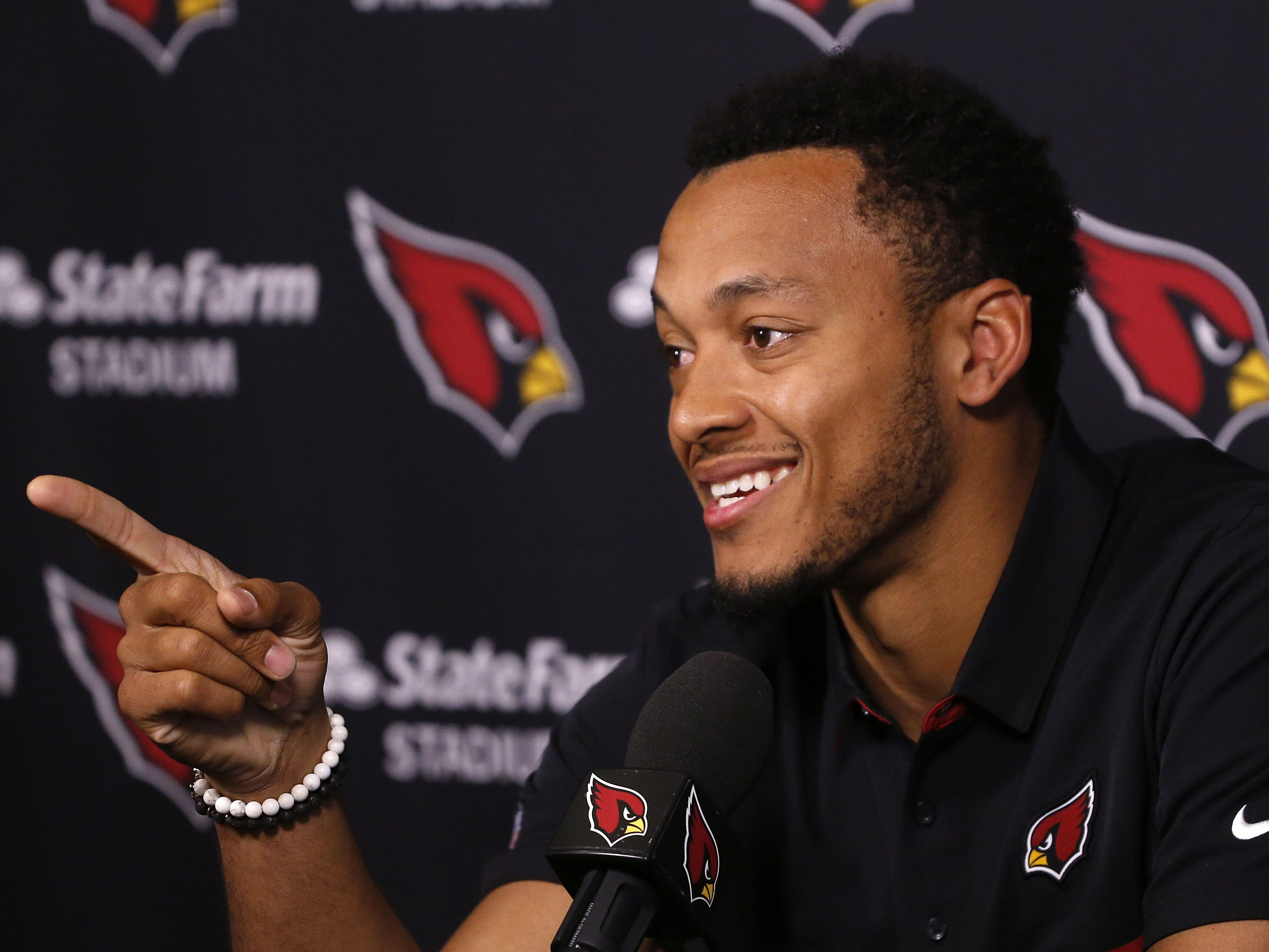 Brett Hundley talks about how his surprise for his parents was upended by the media's quick posting of his signing during his introductory press conference at the Arizona Cardinals Training Facility in Tempe, Ariz. on March 14, 2019.