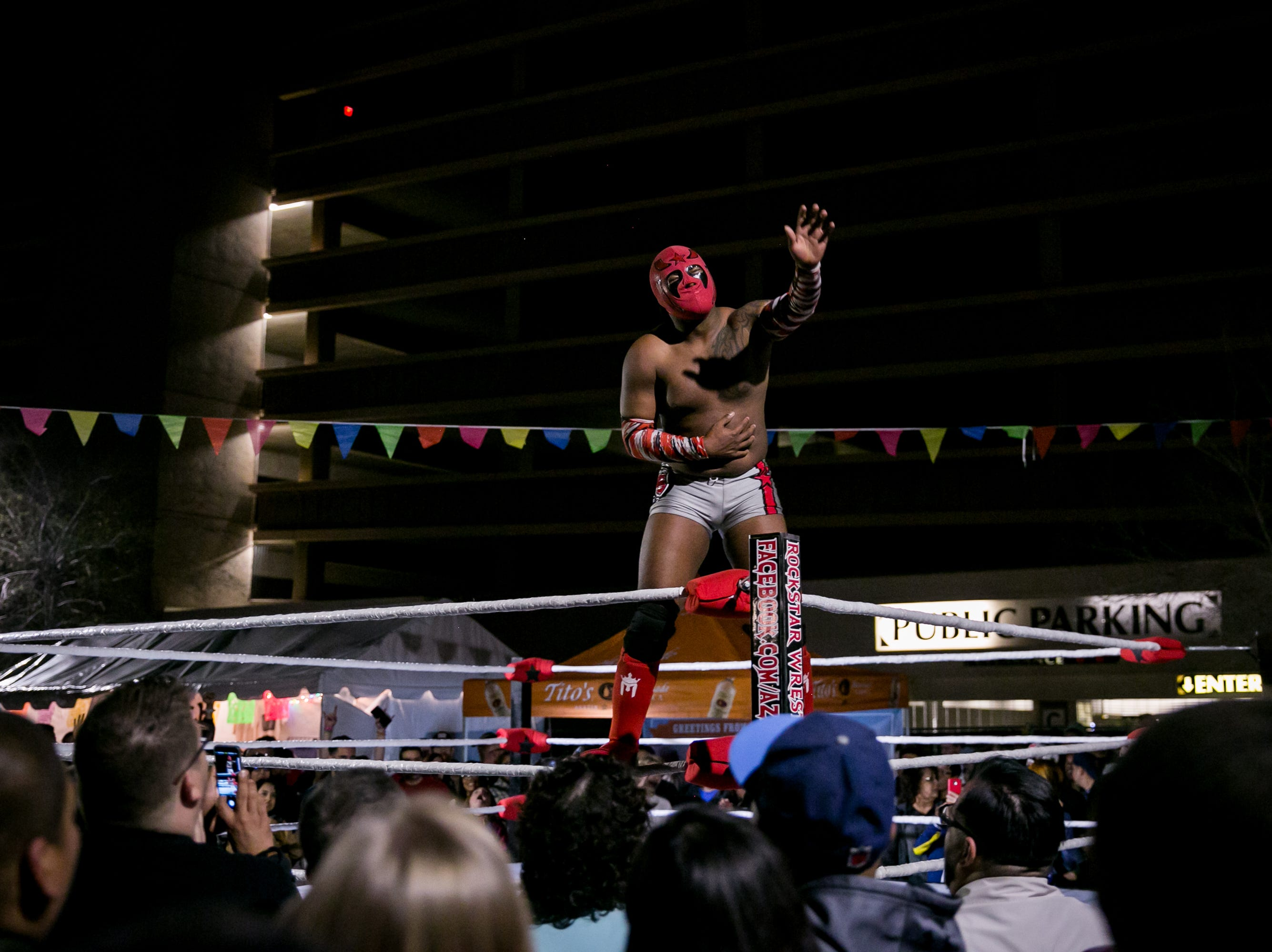 A wrestler celebrates his victory during Flying Burrito Festival at Crescent Ballroom on Saturday, March 9, 2019.