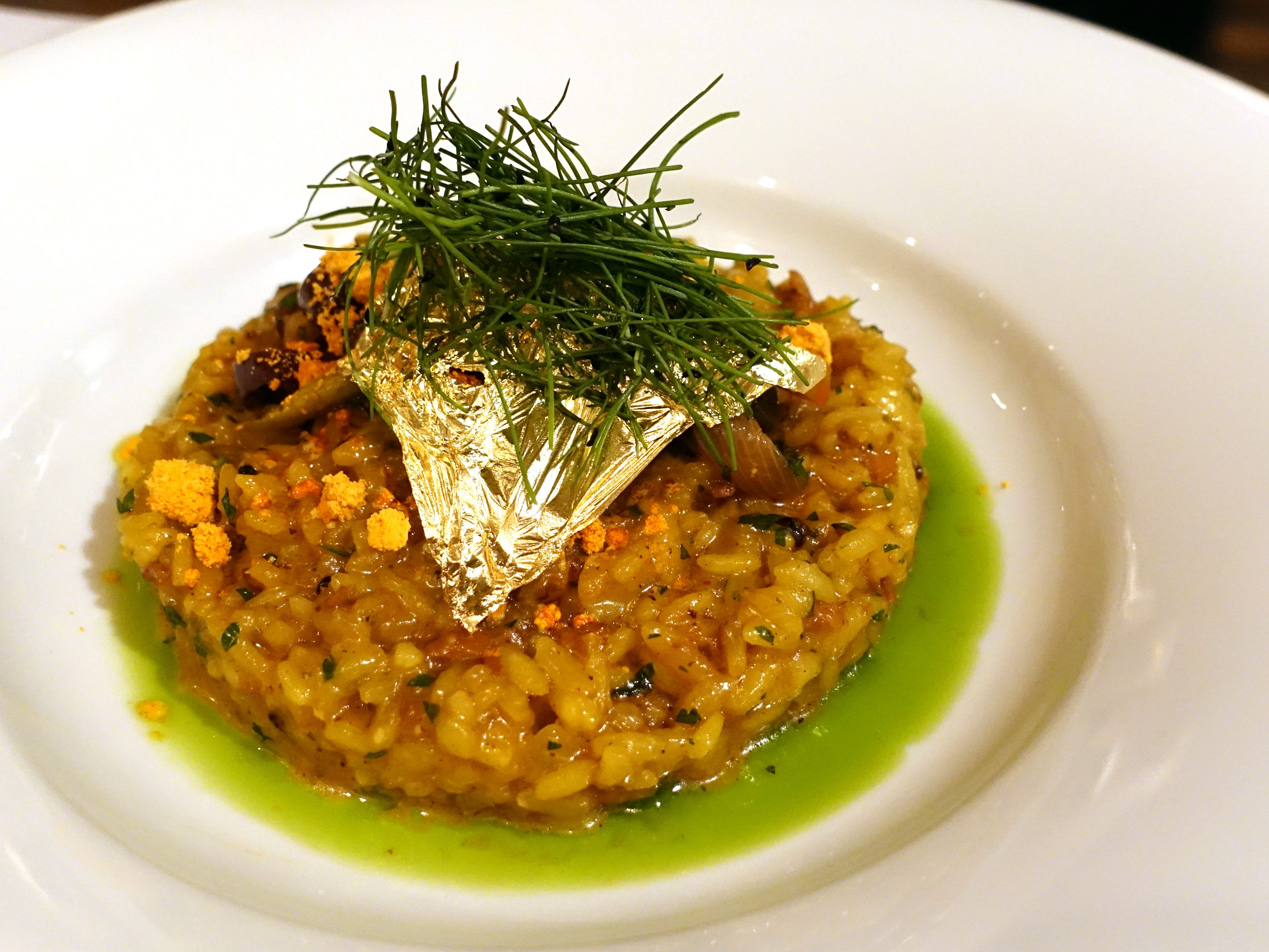 Saffron chorizo risotto with saffron peppers, olives and herb oil at Casa Terra in Glendale.