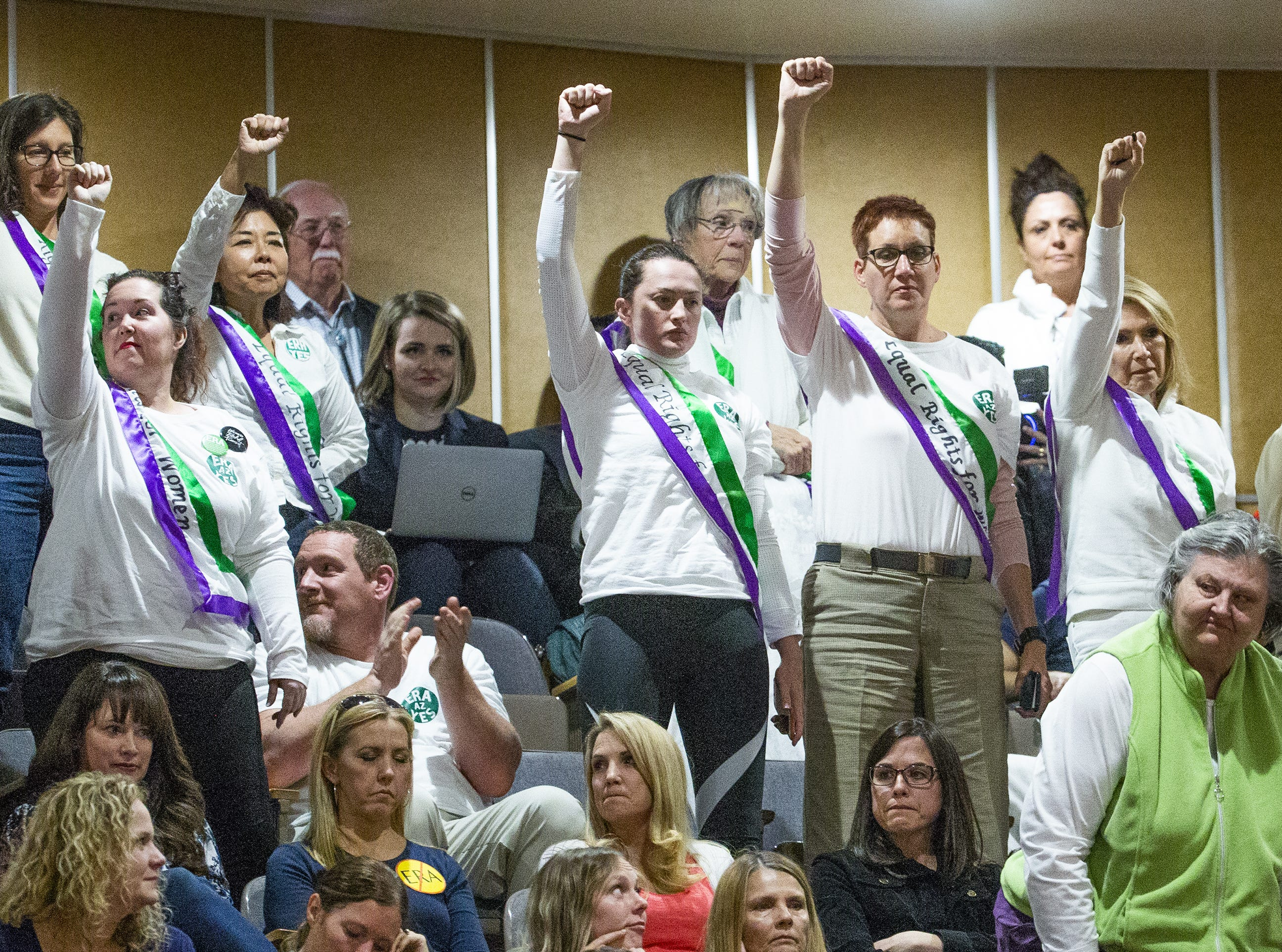 Supporters of the ERA signal their support from the gallery of the Arizona Senate during debate at the Capitol in Phoenix, March 13, 2019.